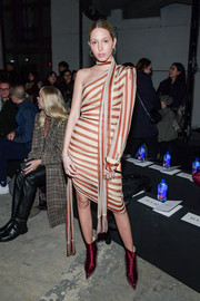Princess Maria-Olympia cut a chic figure in a one-shoulder striped dress with choker detail at the Monse fashion show.
