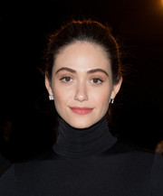 Emmy Rossum was fresh-faced at the Monse fashion show wearing this brushed-back ponytail.