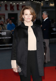 Sigourney Weaver styled her outfit with a metallic brick-patterned clutch for the BFI London Film Festival screening of 'A Monster Calls.'