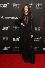 Sara Sampaio was boho-glam in a black lace-panel maxi dress by Elie Saab at the Montblanc 100th anniversary dinner.