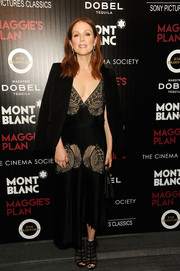 Julianne Moore flaunted some cleavage in a black lace-detail dress by Stella McCartney at the screening of 'Maggie's Plan.'