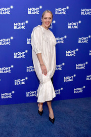 Chloe Sevigny chose a white Simone Rocha dress with a ruffled yoke, puffed sleeves, and a bubble silhouette for the Montblanc Meisterstuck Le Petit Prince event.