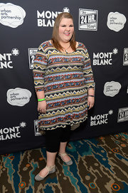 Ashley Fink wore a patterned sweater dress with leggings for a casual look during Montblanc's 24 Hour Plays.