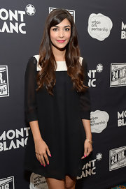 Hannah Simone looked timeless in a black-and-white cocktail dress with sheer sleeves during Montblanc's 24 Hour Plays.
