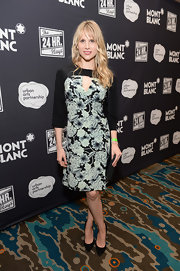 Lucy Punch looked very feminine in a floral dress with peekaboo detailing during Montblanc's 24 Hour Plays.