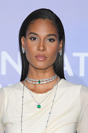 Cindy Bruna added major glamour with a layered diamond and emerald necklace by Orlov.