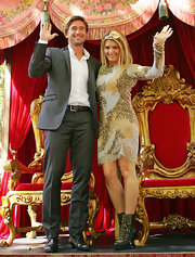 Natalie Bassingthwaighte teamed up her dress with gold studded ankle boots at the Moomba Festival Parade.