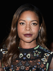 For her lips, Naomie Harris chose a dark berry hue.