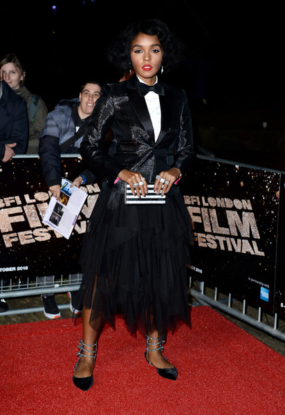 Janelle Monae coordinated her outfit with a black-and-white striped box clutch.