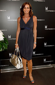 Cristina Parodi slipped on a slate gray cocktail dress with a generous V-neckline as she attended the flagship opening of Moreschi.