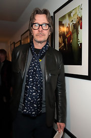 An animal print scarf gave Gary Oldman's look a whimsical feeling during a Hollywood gallery opening.
