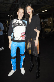 Liu Wen kept it business-chic up top in a black blazer at the Moschino fashion show.