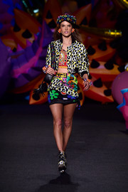 Alessandra Ambrosio walked down the Moschino runway wearing a leopard-print jacket over a crop-top.
