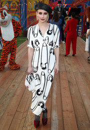 Emma Roberts donned a quirky safety pin-print dress for the Moschino Resort 2019 show.