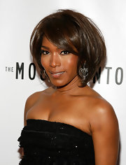 Angela Bassett wore a sheer and shiny nude lipstick to the opening night of 'The Mountaintop' on Broadway.