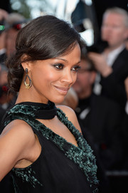 Zoe Saldana pulled her locks back into a romantic loose chignon for the 'Mr. Turner' premiere.
