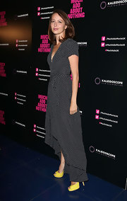 Amy Acker chose a black and white polka dot asymmetrical flowing dress for her look at the 'Much Ado About Nothing' screening in London.