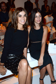 Carine Roitfeld styled a simple black boatneck sweater with a grommeted leather skirt for the Mugler fashion show.