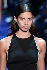 Sara Sampaio wore her hair slicked down at the top and billowy at the ends during the Mugler runway show.