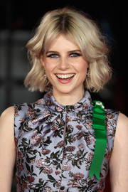 Lucy Boynton framed her face with a short wavy 'do for the world premiere of 'Murder on the Orient Express.'