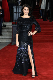 Penelope Cruz kept it classic and elegant in a black Temperley London sequin gown with fluted sleeves and a high slit at the world premiere of 'Murder on the Orient Express.'