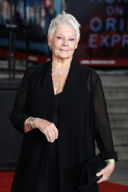 Judi Dench sported an all-black suede clutch, coat, and dress combo at the world premiere of 'Murder on the Orient Express.'