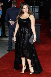 A silver clutch topped off Kelly Brook's red carpet ensemble.