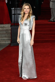 Michelle Pfeiffer was futuristic-glam in a silver lamé gown by Prada, featuring a deep-V neckline and draped shoulders, at the world premiere of 'Murder on the Orient Express.'