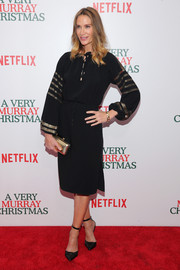 Kelly Lynch went for boho elegance in a black peasant dress accented with gold sequin stripes during the New York premiere of 'A Very Murray Christmas.'