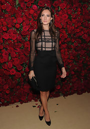 Zani Gugelmann wore a black lacy cocktail dress with a bowed waist for the MOMA benefit in NYC.