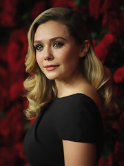 Elizabeth Olsen wore her long curls in a retro side-sweep at the Museum of Modern Art's 4th Annual Film Benefit.