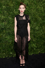 Rooney Mara cut a seductive figure in a sheer lace LBD by Givenchy during the Museum of Modern Art's film benefit.