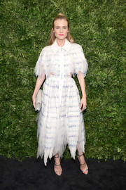 Diane Kruger looked very fashion-forward in a white and blue tattered-effect cutout dress by Chanel at the Museum of Modern Art's film benefit.