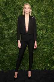 Lily Donaldson gave her black suit an ultra-sexy punch with that deep-V lace peeking from under the jacket!