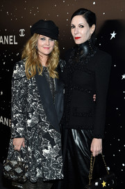 Drew Barrymore attended the MoMA Tribute to Martin Scorsese carrying a chic beaded purse.