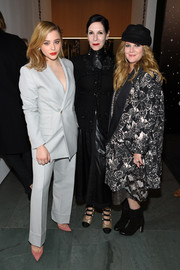 Chloe Grace Moretz looked impeccable in a gray Dior Homme suit at the MoMA Tribute to Martin Scorsese.
