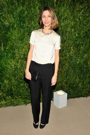 Sofia Coppola opted for a dressed-down look when she attended the MoMA film benefit, consisting of a short-sleeve white button-down with a Peter Pan collar and a pair of black slacks.