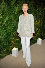 Tilda Swinton's white Chanel wide-leg pants and tweed jacket were an impeccable pairing.