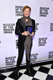 Annette Bening styled her black outfit with a long gray scarf.