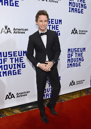 Eddie Redmayne looked dashing and cool in a classic tuxedo as he attending the Museum of Moving Image event saluting Hugh Jackman.
