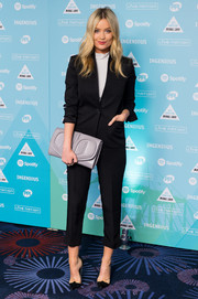 A little ankle never hurt anyone. Laura Whitmore's cropped trousers and blazer made for a sharp ensemble at the Music Industry Trust Awards.