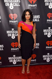 Demi Lovato cut a shapely silhouette in a body-con color-block cutout dress by Mugler while attending 'A Night to Celebrate Elvis Duran.'