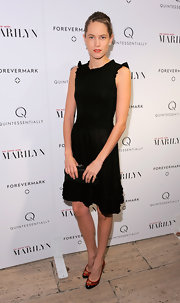 Cody Horn paired her classic black dress with patterned red pumps.