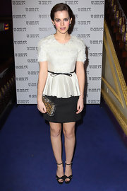 Emma Watson modernized her sweet screening style with a plexi Pandora clutch, which revealed a leopard print pouch.