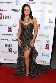 Mya chose a ruffled, strapless mermaid gown with a sexy front slit for her look on the red carpet.