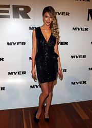 Jennifer Hawkins sizzled at the Myer Autumn/Winter Launch in black suede platform pumps.