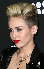 A bright and bold red lip gave Miley a touch of instant glam.