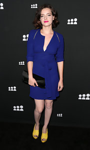 Roxane Mesquida chose a blue slouchy dress for her look at the Myspace Event in LA.