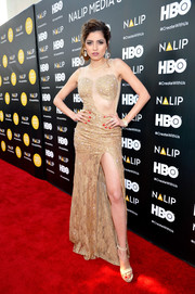 Blanca Blanco flaunted some leg at the NALIP 2016 Latino Media Awards in a nude illusion-panel lace gown with a dangerously high slit.