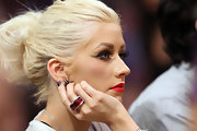 Christina sat courtside during the NBA Finals, where she flashed a huge red cocktail ring.